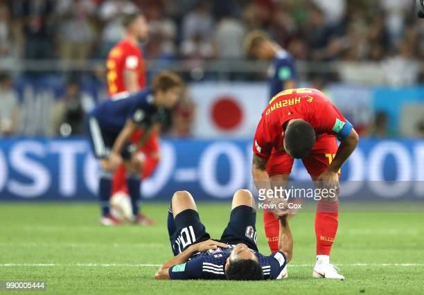 Romelu Lukaku of Belgium consoles Shinji Kagawa of Japan during the 2018 FIFA World Cup Russia Round of 16 match between Belgium and Japan at Rostov...