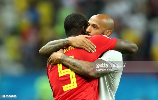 Romelu Lukaku of Belgium embraces Belgium assistant coach Thierry Henry in celebration following the 2018 FIFA World Cup Russia Quarter Final match...