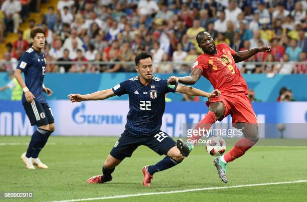 Romelu Lukaku of Belgium fails to connect with the ball in the box under pressure from Maya Yoshida of Japan during the 2018 FIFA World Cup Russia...