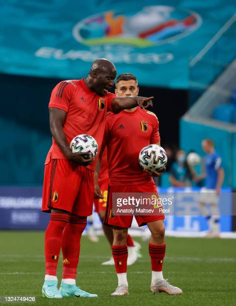 Romelu Lukaku of Belgium interacts with team mate Leandro Trossard as they warms up prior to the UEFA Euro 2020 Championship Group B match between...