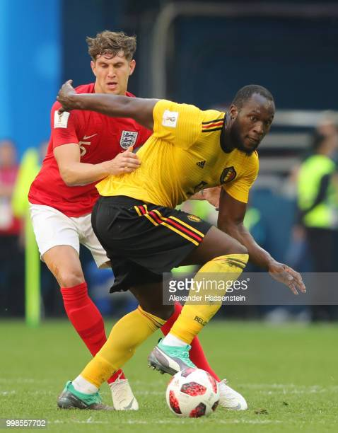 Romelu Lukaku of Belgium is challenged by John Stones of England during the 2018 FIFA World Cup Russia 3rd Place Playoff match between Belgium and...