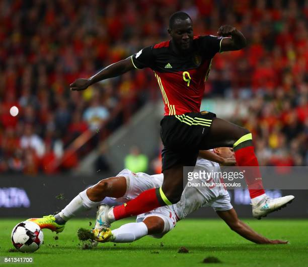 Romelu Lukaku of Belgium is tackled by Jason Pusey of Gibraltar during the FIFA 2018 World Cup Qualifier between Belgium and Gibraltar at Stade...