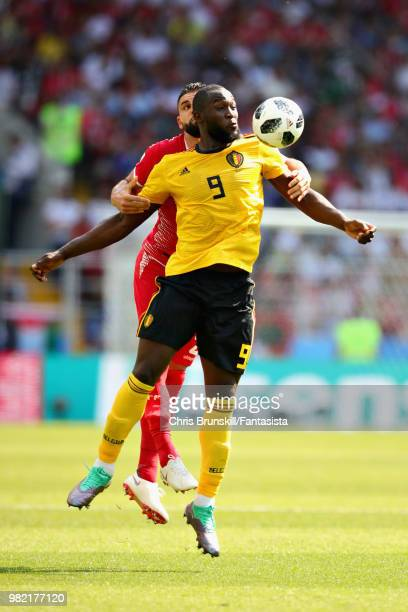 Romelu Lukaku of Belgium jumps for a header with Hamdi Nagguez of Tunisia during the 2018 FIFA World Cup Russia group G match between Belgium and...