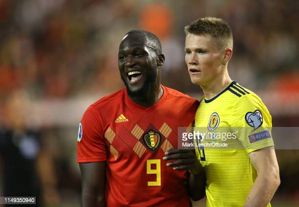 Romelu Lukaku of Belgium laughs as he stands with Scott McTominay of Scotland during the UEFA Euro 2020 qualifying match between Belgium and Scotland...