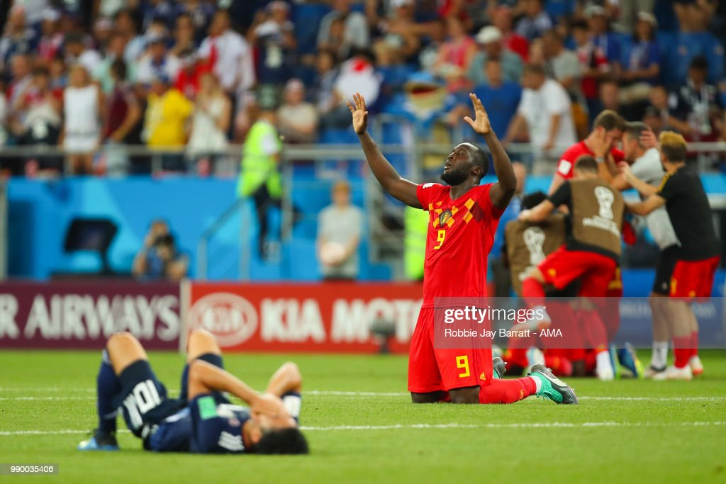 Romelu Lukaku of Belgium reacts as Shinji Kagawa of Japan looks dejected at the end of the 2018 FIFA World Cup Russia Round of 16 match between Belgium and Japan at Rostov Arena on July 2, 2018 in Rostov-on-Don, Russia.
