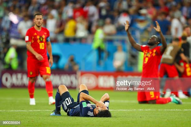 Romelu Lukaku of Belgium reacts as Shinji Kagawa of Japan looks dejected at the end of the 2018 FIFA World Cup Russia Round of 16 match between...