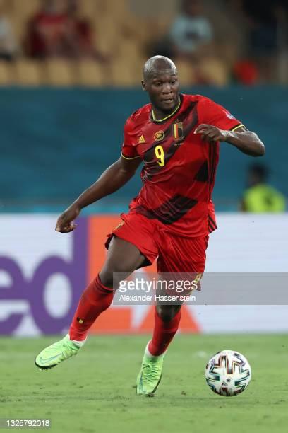 Romelu Lukaku of Belgium runs with the ball during the UEFA Euro 2020 Championship Round of 16 match between Belgium and Portugal at Estadio La...