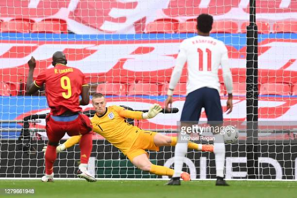 Romelu Lukaku of Belgium scores his team's first goal from the penalty spot as Jordan Pickford of England fails to save during the UEFA Nations...