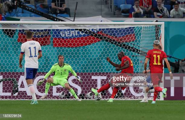 Romelu Lukaku of Belgium scores their side's first goal past Mario Fernandes of Russia during the UEFA Euro 2020 Championship Group B match between...