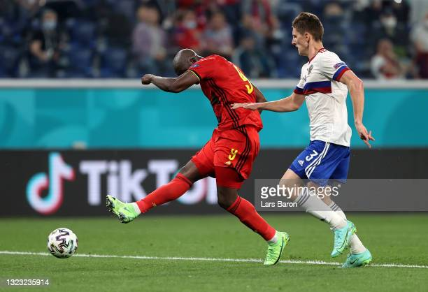 Romelu Lukaku of Belgium scores their side's third goal whilst under pressure from Igor Diveev of Russia during the UEFA Euro 2020 Championship Group...