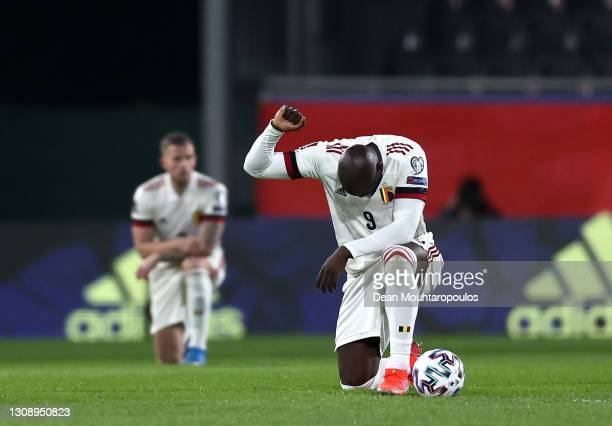 Romelu Lukaku of Belgium takes a knee in support of the Black Lives Matter movement prior to the FIFA World Cup 2022 Qatar qualifying match between...