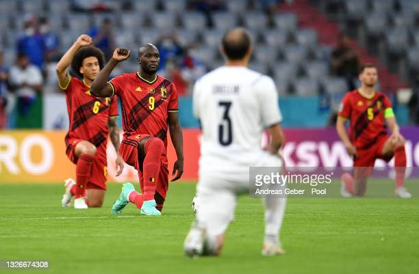 Romelu Lukaku of Belgium takes a knee in support of the Black Lives Matter movement prior to the UEFA Euro 2020 Championship Quarter-final match...