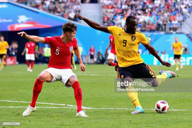 Romelu Lukaku of Belgium takes a shot as John Stones of England tries to block during the 2018 FIFA World Cup Russia 3rd Place Playoff match between...