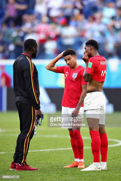 Romelu Lukaku of Belgium talks with Jesse Lingard and Marcus Rashford both of England after the 2018 FIFA World Cup Russia 3rd Place Playoff match...