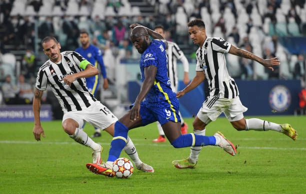 Romelu Lukaku of Chelsea FC challenged by Leonardo Bonucci of Juventus and Danilo of Juventus during the UEFA Champions League group H match between...