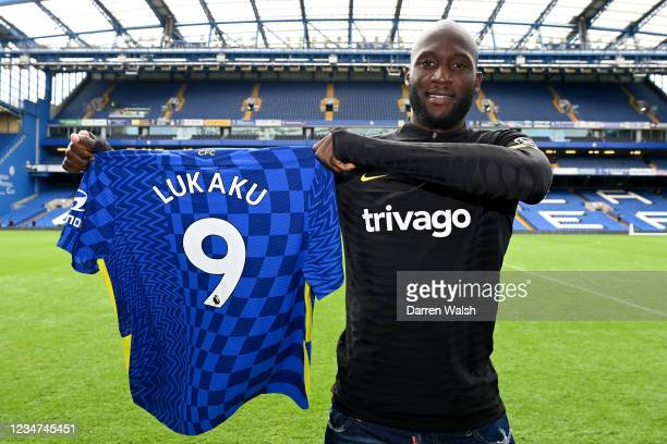 Romelu Lukaku of Chelsea holds his number 9 shirt after a training session at Stamford Bridge on August 18, 2021 in London, England.