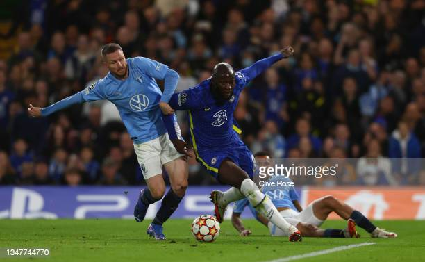 Romelu Lukaku of Chelsea is tackled by Lasse Nielsen of Malmo FF which leads to a penalty decision for Chelsea during the UEFA Champions League group...