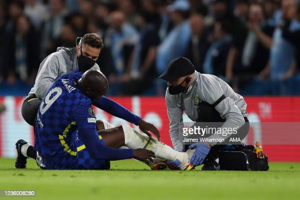 Romelu Lukaku of Chelsea receives treatment on his ankle before being substituted during the UEFA Champions League group H match between Chelsea FC...