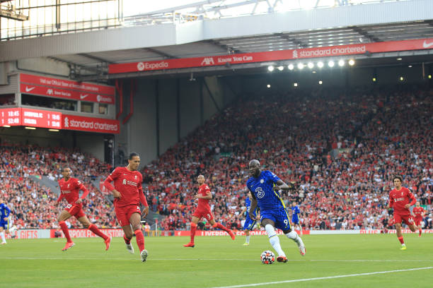 Romelu Lukaku of Chelsea runs at Virgil van Dijk of Liverpool during the Premier League match between Liverpool and Chelsea at Anfield on August 28,...