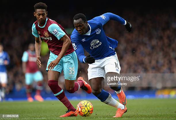 Romelu Lukaku of Everton and Reece Oxford of West Ham United compete for the ball during the Barclays Premier League match between Everton and West...