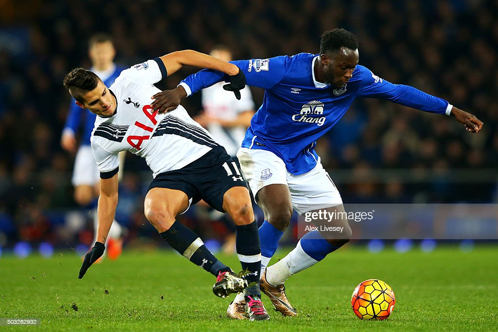 Romelu Lukaku of Everton battlea for the ball with Erik Lamela of Tottenham Hotspur during the Barclays Premier League match between Everton and Tottenham Hotspur at Goodison Park on January 3, 2016 in Liverpool, England.