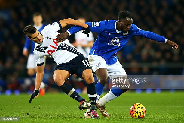 Romelu Lukaku of Everton battlea for the ball with Erik Lamela of Tottenham Hotspur during the Barclays Premier League match between Everton and...