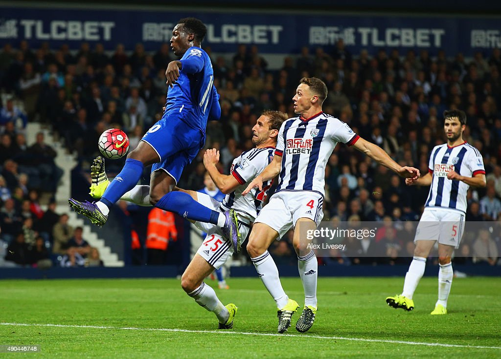 Romelu Lukaku of Everton beats Craig Dawson (25) and James Chester of West Bromwich Albion (4) as he scores their third goal during the Barclays Premier League match between West Bromwich Albion and Everton at The Hawthorns on September 28, 2015 in West Bromwich, United Kingdom.