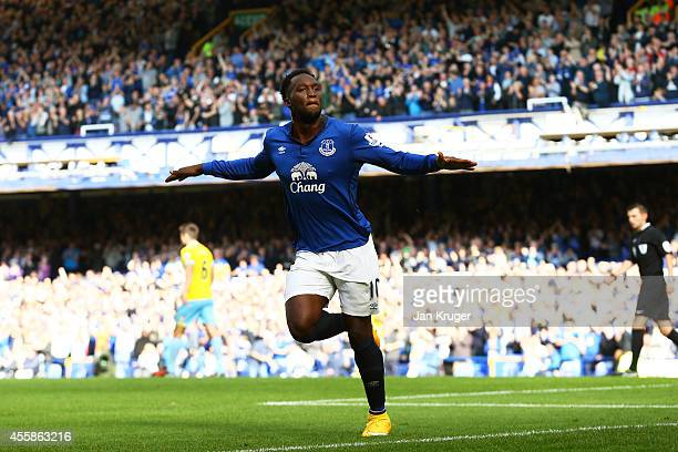 Romelu Lukaku of Everton celebrates after scoring the opening goal during the Barclays Premier League match between Everton and Crystal Palace at...