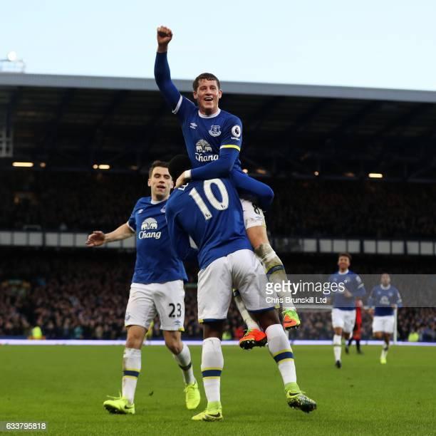 Romelu Lukaku of Everton celebrates scoring his side's fifth goal with teammate Ross Barkley during the Premier League match between Everton and AFC...