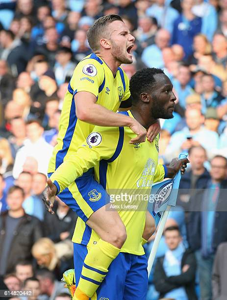 Romelu Lukaku of Everton celebrates scoring his sides first goal with his team mate Tom Cleverley of Everton during the Premier League match between...