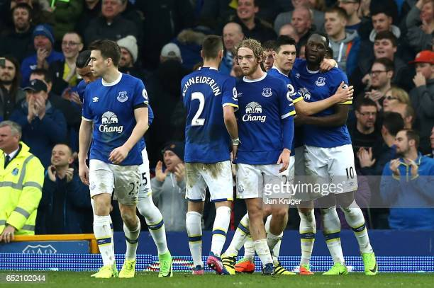 Romelu Lukaku of Everton celebrates scoring his sides third goal with his Everton team mates during the Premier League match between Everton and West...