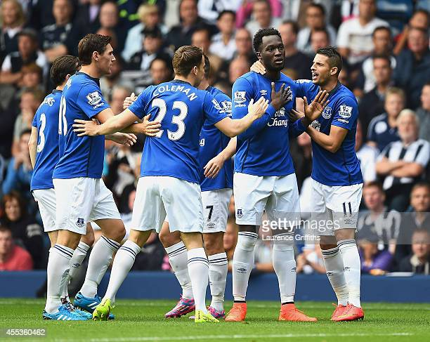 Romelu Lukaku of Everton celebrates scoring the opening goal with team mates during the Barclays Premier League match between West Bromwich Albion...