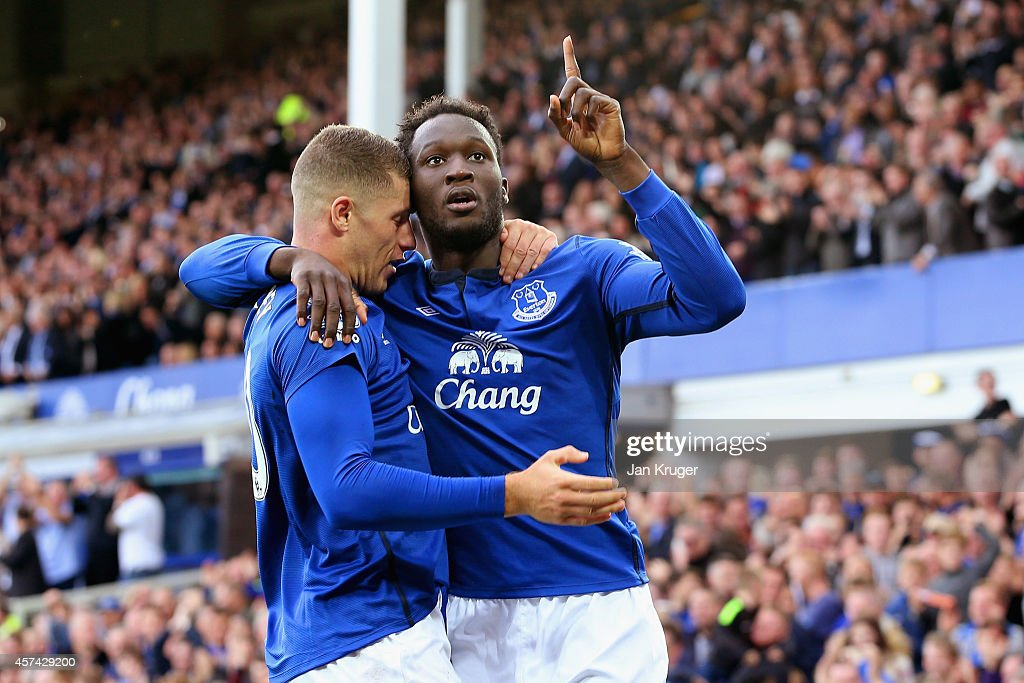 Romelu Lukaku of Everton celebrates scoring their second goal with Ross Barkley of Everton during the Barclays Premier League match between Everton and Aston Villa at Goodison Park on October 18, 2014 in Liverpool, England.