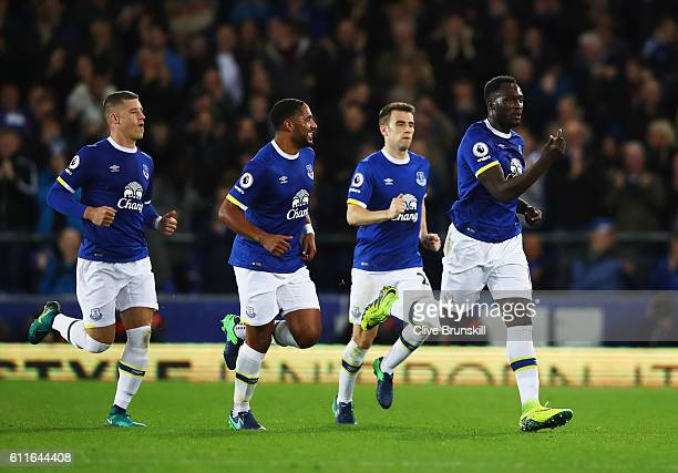 Romelu Lukaku of Everton celebrates with team mates as he scores their first goal from a free kick during the Premier League match between Everton...