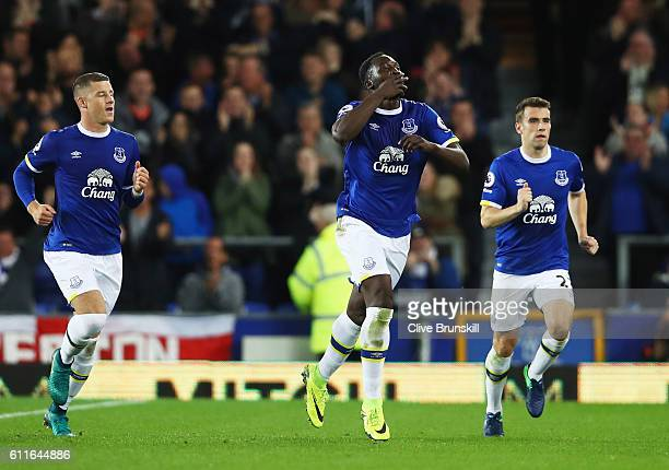 Romelu Lukaku of Everton celebrates with team mates Ross Barkley and Seamus Coleman as he scores their first goal from a free kick during the Premier...