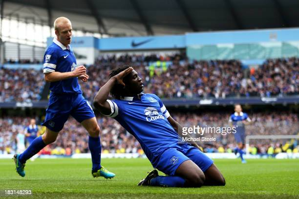 Romelu Lukaku of Everton celebrates with teammate Steven Naismith after scoring the opening goal during the Barclays Premier League match between...
