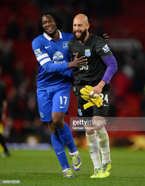Romelu Lukaku of Everton celebrates with Tim Howard at the end of the Barclays Premier League match between Manchester United and Everton at Old...