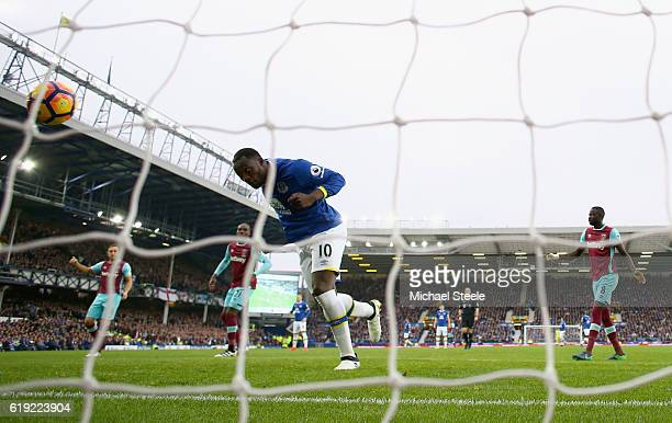 Romelu Lukaku of Everton heads home to score his sides first goal during the Premier League match between Everton and West Ham United at Goodison...