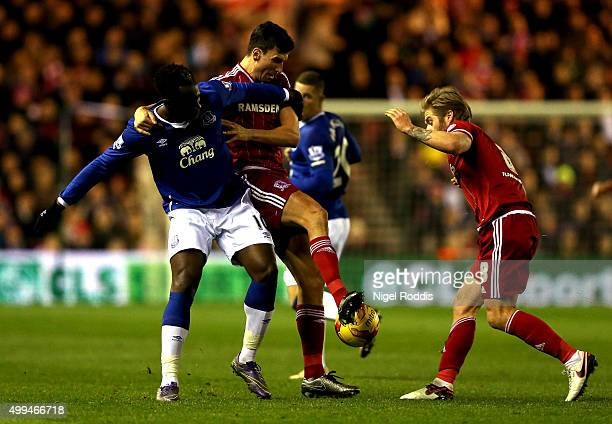 Romelu Lukaku of Everton is challeged by Adam Clayton and Daniel Ayala of Middlesbrough during their Capital One Cup Quarter Final at Riverside...