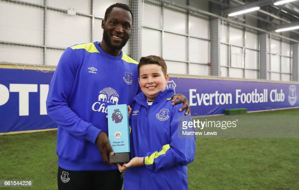 Romelu Lukaku of Everton is presented with the EA SPORTS Player of the Month award from Logan at USM Finch Farm on March 30 2017 in Halewood England