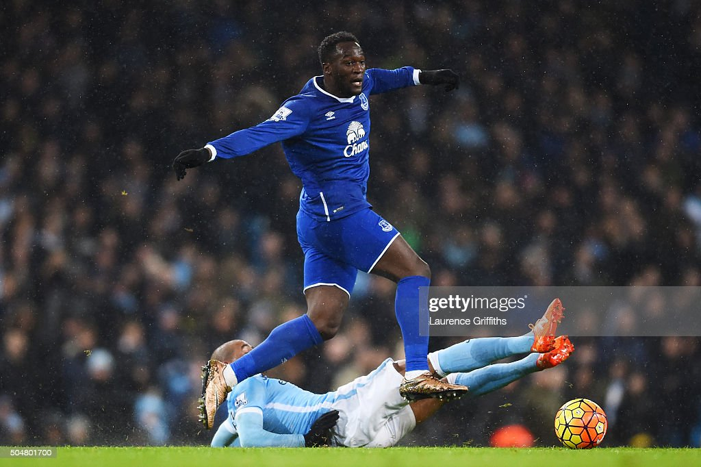 Romelu Lukaku of Everton is tackled by Fernando of Manchester City during the Barclays Premier League match between Manchester City and Everton at the Etihad Stadium on January 13, 2016 in Manchester, England.