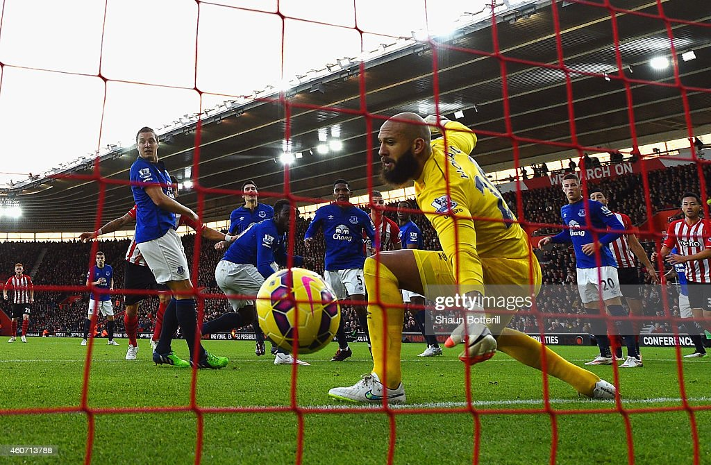 Romelu Lukaku of Everton scores an own goal past Tim Howard of Everton during the Barclays Premier League match between Southampton and Everton at St Mary's Stadium on December 20, 2014 in Southampton, England.