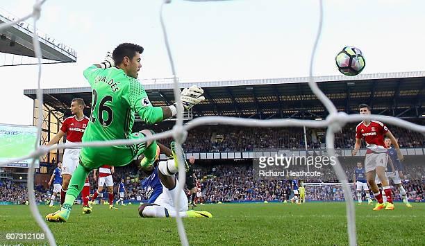 Romelu Lukaku of Everton scores his sides third goal past goalkeeper Victor Valdes of Middlesbrough during the Premier League match between Everton...