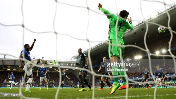 Romelu Lukaku of Everton scores his sides third goal past goalkeeper Ben Foster of West Bromwich Albion during the Premier League match between...