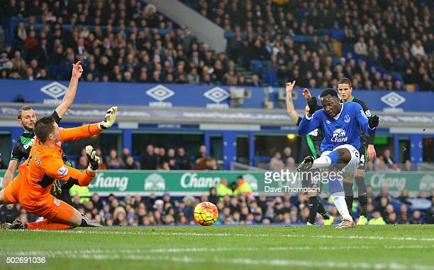 Romelu Lukaku of Everton scores his team's first goal during the Barclays Premier League match between Everton and Stoke City at Goodison Park on...