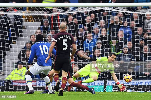 Romelu Lukaku of Everton scores the opening goal during the Premier League match between Everton and Manchester City at Goodison Park on January 15...