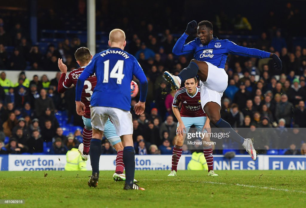 Romelu Lukaku of Everton (R) scores their first and equalising goal during the FA Cup Third Round match between Everton and West Ham United at Goodison Park on January 6, 2015 in Liverpool, England.