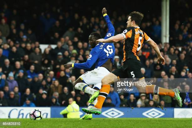 Romelu Lukaku of Everton scores their fourth goal as Harry Maguire of Hull City moves in during the Premier League match between Everton and Hull...