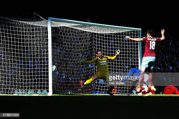 Romelu Lukaku of Everton scores their second goal past Adrian of West Ham during the Barclays Premier League match between West Ham United and...