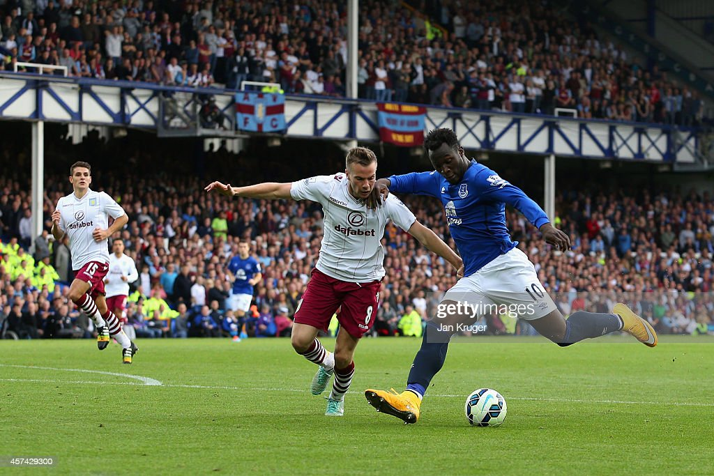 Romelu Lukaku of Everton scores their second goal under pressure from Tom Cleverley of Aston Villa during the Barclays Premier League match between Everton and Aston Villa at Goodison Park on October 18, 2014 in Liverpool, England.